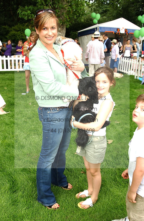 Radio presenter EMMA FORBES and her daughter LILLY and Alfie at the Macmillan Cancer Relief Dog Day held at the Royal Hospital Chelsea South Grounds, London on 6th July 2004.