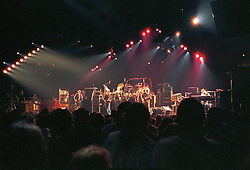 Levels Processed for Saturation, Tone Mapping and Levels. The Grateful Dead Live at The Capital Centre, Landover MD on the 16th of March 1990. Shot on the floor from Stage Left about 20 or so rows back. Wide with Fans, Lights and Band.