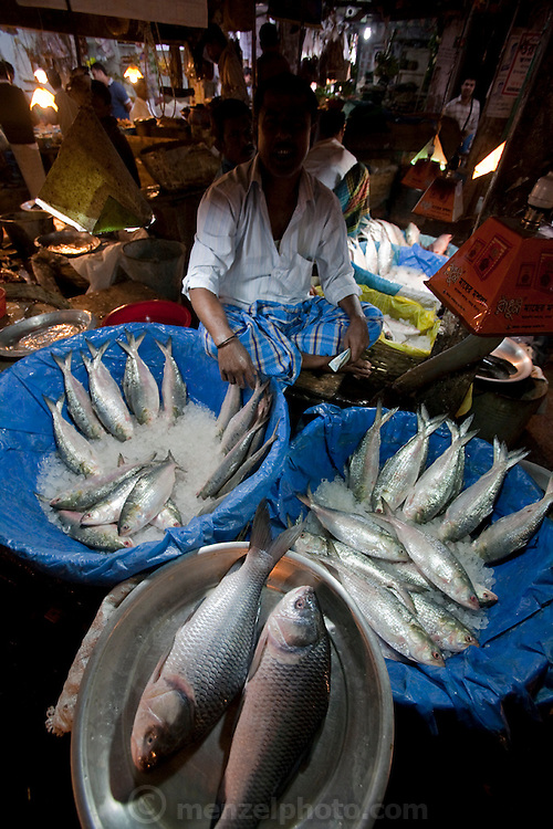A vendor waits for customers at the Santinagar Market in   Dhaka, Bangladesh.