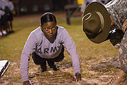 A female Drill Sergeant candidates at the US Army Drill Instructors School Fort Jackson take their entry physical training test early morning September 27, 2013 in Columbia, SC. While 14 percent of the Army is women soldiers there is a shortage of female Drill Sergeants.