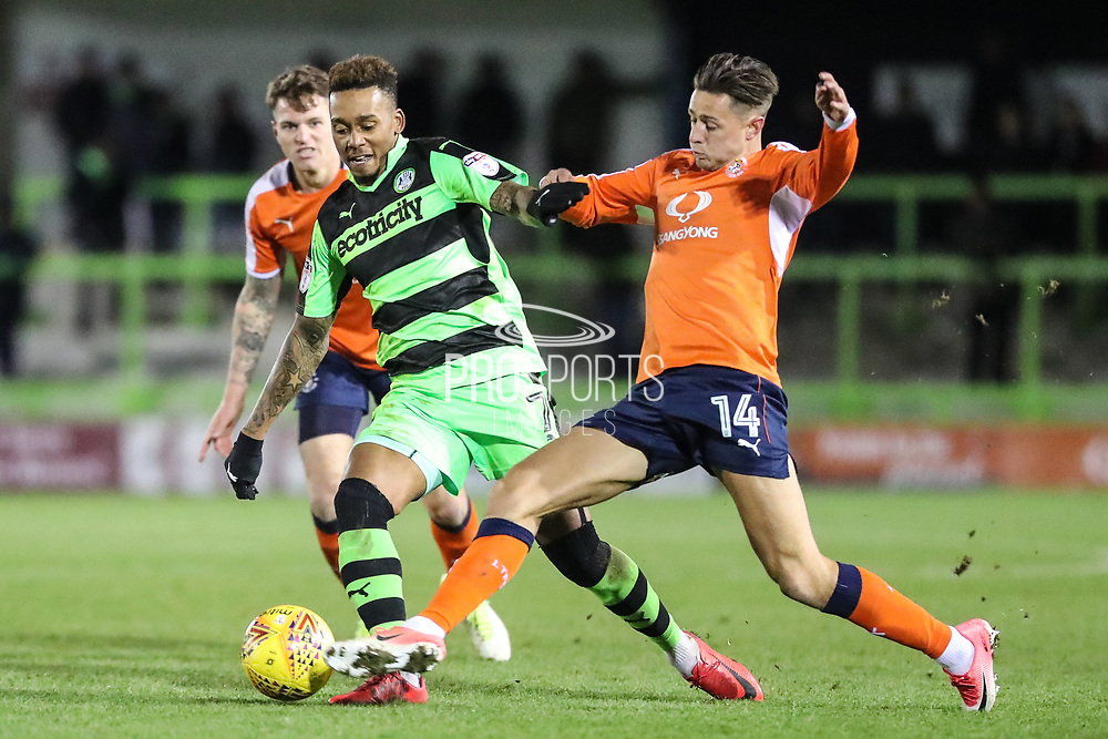 Forest Green Rovers Keanu Marsh-Brown(7) is tackled by Luton Towns Harry Cornick during the EFL Sky Bet League 2 match between Forest Green Rovers and Luton Town at the New Lawn, Forest Green, United Kingdom on 16 December 2017. Photo by Shane Healey.