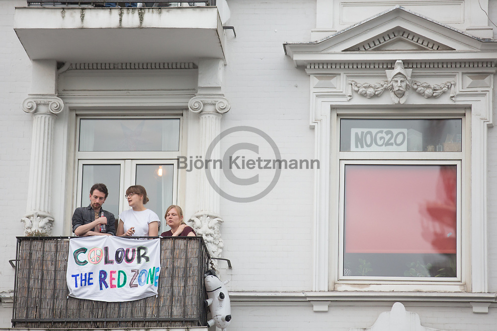 Hamburg, Germany - 05.07.2017<br /> <br /> Residents with anti-G20 banners watching the demonstration.Anti-G20 rave under the slogan &rdquo;Lieber tanz ich als G20&rdquo; (&quot;I prefer to dance instead of G20&rdquo;) moves through Hamburg. According to police, about 12,000 people are involved, according to the organizers more than 25,000 people participate.<br /> <br /> Anwohner mit Anti-G20 Bannern beobachten die Demonstration. Anti-G20 Nachttanz-Demo unter dem Motto &rdquo;Lieber tanz ich als G20&rdquo; zieht durch Hamburg. Laut Polizei beteiligen sich etwa 12.000 Personen, laut den Veranstaltern nehmen mehr als 25.000 Menschen teil. <br /> <br /> Photo: Bjoern Kietzmann