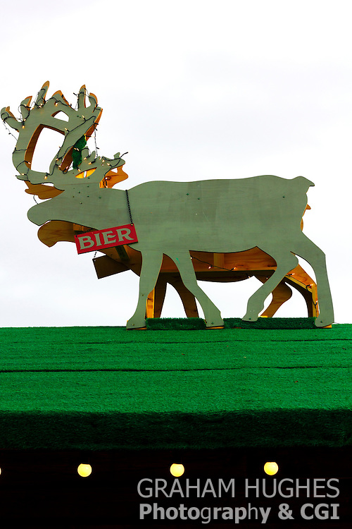 Edinburgh Christmas Market. Winter Time. Bier Reindeer On top of Shop or Hut Roof