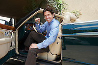 Man Sitting in a Convertible Holding Car Keys