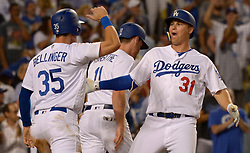 June 27, 2017 - Los Angeles, California, U.S. - Los Angeles Dodgers' Joc Pederson (31) reacts with teammate Cody Bellinger (35) after hitting a three run home run against the Los Angeles Angels in the sixth inning of a Major League baseball game at Dodger Stadium on Tuesday, June 27, 2017 in Los Angeles. (Photo by Keith Birmingham, Pasadena Star-News/SCNG) (Credit Image: © San Gabriel Valley Tribune via ZUMA Wire)