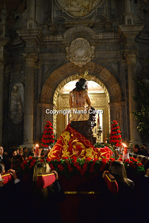 Holy week procession enters Colegiata de San Justo y Pastor in Granada, Spain