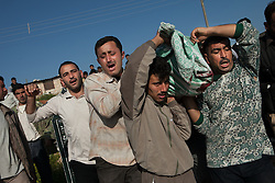 Friends and relatives carrying the death body of Mohamed Abed Alsalam, 32, at his funeral. A Syrian citizen killed due to an attack by the Syrian forces. Anadan, north Syria, saturday, April 21, 2012..Saturday morning eight members of the FSA and one civilian were killed by the result of an ambush made by mercenaries and security forces close to a checkpoin in the outskirts of Babis, north Aleppo. ..*In this town, 10 persons have been found dead,15 wounded and one missing in an attack were 18 tanks, 14 military cars and arround 300 soldiers burned down 118 houses and 120 shops in a operation by the Syrian regime of Bashar-Al-Assad at April 13th and 14th activist says., Syria, April 21, 2012. Photo by Daniel Leal-Olivas / i-Images...