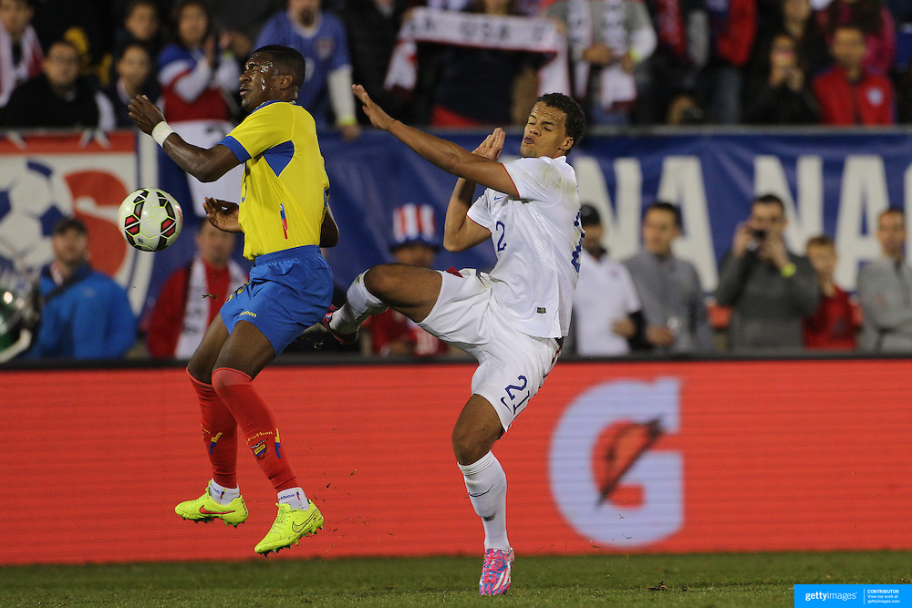 Frickson Erazo, (left), Ecuador, is challenged by Timothy Chandler, USA, during the USA Vs Ecuador International match at Rentschler Field, Hartford, Connecticut. USA. 10th October 2014. Photo Tim Clayton