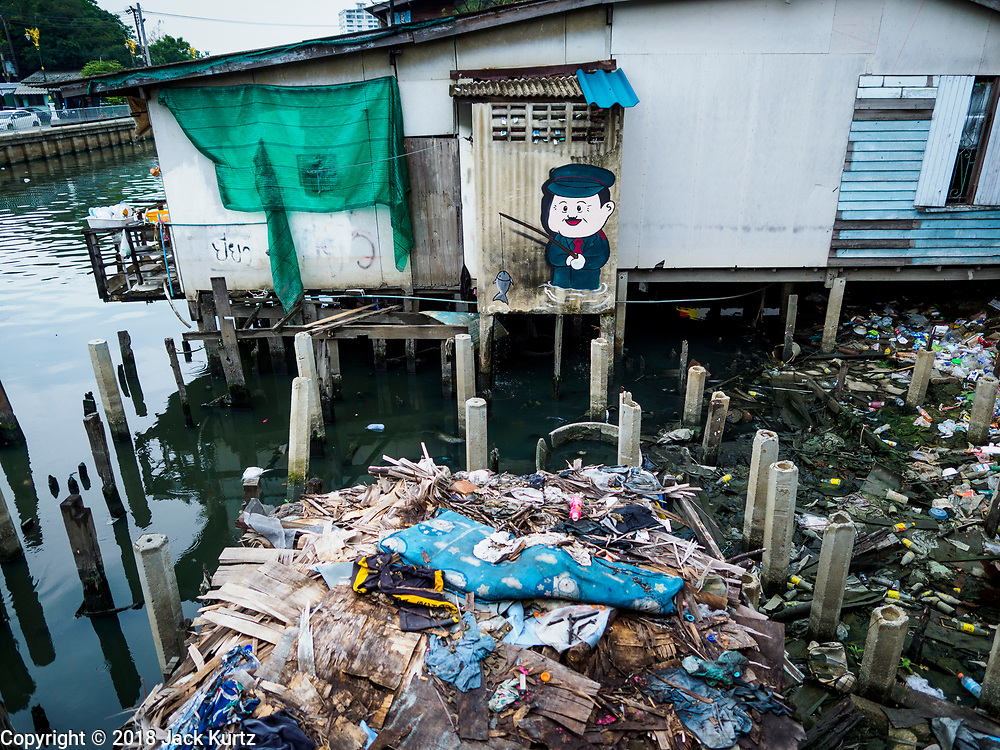 "22 MARCH 2018 - BANGKOK, THAILAND:  A demolished home along Khlong Lat Phrao. Bangkok officials are evicting about 1,000 families who have set up homes along Khlong  Lat Phrao in Bangkok, the city says they are ""encroaching"" on the khlong. Although some of the families have been living along the khlong (Thai for ""canal"") for generations, they don't have title to the property, and the city considers them squatters. The city says the residents are being evicted so the city can build new embankments to control flooding. Most of the residents have agreed to leave, but negotiations over compensation are continuing for residents who can't afford to move.     PHOTO BY JACK KURTZ"