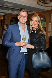 WILLIAM SITWELL and EMILY LOPES at a party hosted by Ewan Venters CEO of Fortnum & Mason to celebrate the launch of The Cook Book by Tom Parker Bowles held at Fortnum & Mason, 181 Piccadilly, London on 18th October 2016.
