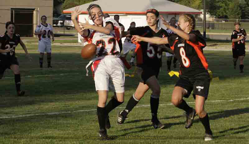 Junior Sam Harp (22) almost makes a great catch as seniors Niki Kuhlman (55) and Brittany Tonne (8) defend during the 3rd Annual Powderpuff Challenge, the junior girls (class of 2008) against the senior girls (class of 2007.)