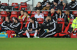 Gareth Bale of Wales (Real Madrid) pictured smiling on the bench. - Photo mandatory by-line: Alex James/JMP - Tel: Mobile: 07966 386802 05/03/2014 - SPORT - FOOTBALL - Cardiff - Cardiff City Stadium - Wales v Iceland - International Friendly