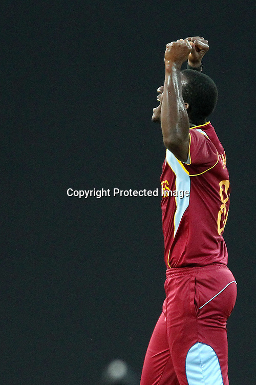 Darren Sammy (Captain) of The West Indies celebrates the wicket of Martin Guptil during the ICC World Twenty20 Super Eights match between The West Indies and New Zealand held at the  Pallekele Stadium in Kandy, Sri Lanka on the 1st October 2012<br /> <br /> Photo by Ron Gaunt/SPORTZPICS/PHOTOSPORT