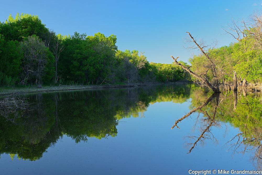 Reflection on the Seine River. Seine River Forest.<br /> Winnipeg<br /> Manitoba<br /> Canada