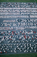 Cars and trucks parked in carpark view from above