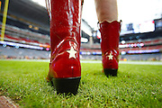 A Houston Texans fan wore bright red cowboy boots to the Seattle Seahawks vs. Houston Texans game at Reliant Stadium in 2013, in Houston. (John Lok / The Seattle Times)