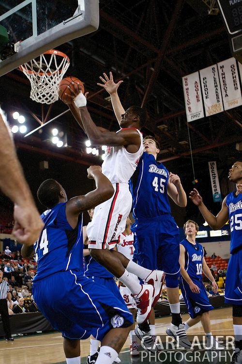 November 26th, 2010:  Anchorage, Alaska - St. John's senior forward Justin Burrell (24) puts up a shot in the Red Storm's semi final game of the Great Alaska Shootout against the Drake Bulldogs.  The Red Storm defense held Drake to a tournament low score as St. Johns advanced to the final game 82-39.