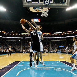 February 7, 2011; New Orleans, LA, USA; Minnesota Timberwolves power forward Kevin Love (42) is defended by New Orleans Hornets center Aaron Gray (34) during the first half at the New Orleans Arena.   Mandatory Credit: Derick E. Hingle