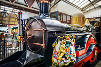 London, UK  England - October 3, 2012: An antique train engine sits on display in the train station.