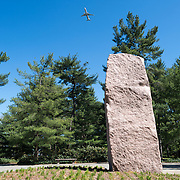 Pink granite monolith at the Lyndon Baines Johnson Memorial Grove. The memorial is set in Lady Bird Johnson Park on the banks of the Potomac on the George Washington Memorial Parkway in Arlington, Virginia.