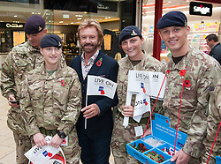 © Licensed to London News Pictures. 29/10/2015. Bristol, UK. Bristol Poppy Day. NOEL EDMONDS joins members of 47 Regiment Royal Artillery to raise the profile of the Royal British Legion's Poppy Appeal campaign in Bristol at Cabot Circus shopping centre, in the two week countdown to Remembrance Day. Photo credit : Simon Chapman/LNP