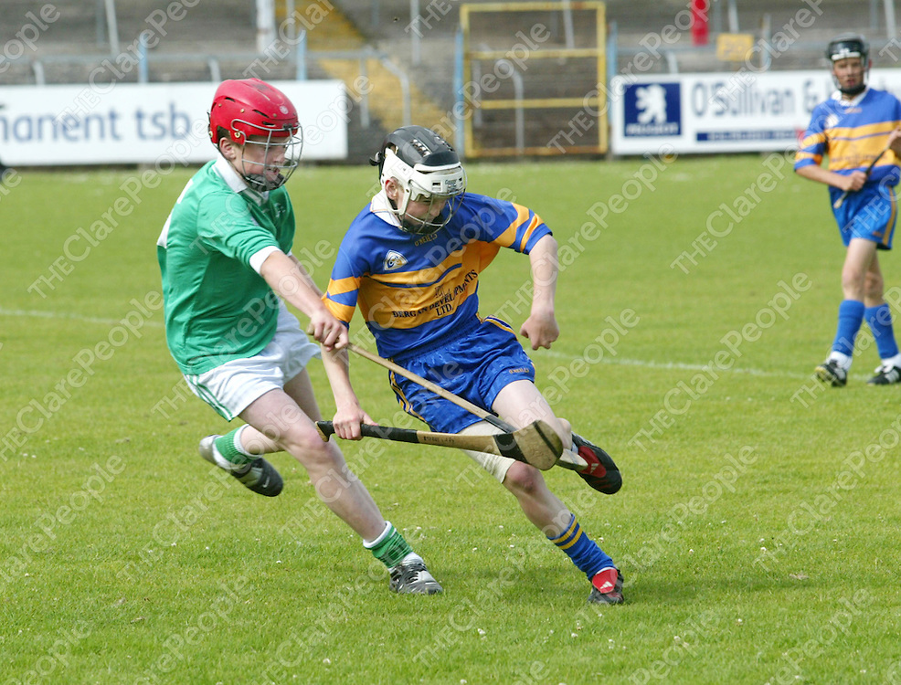 Clare Primary Schools Finals between Scariff & Newmarket on Fergus National Schools. Pictured are Newmarket on Fergus's Shane Liddy grabbing the bal and fighting off the attacks from Scariff's David Durack. Pic. Emma Jervis/ Press 22.