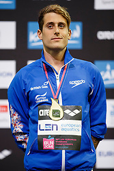 Chris Walker-Hebborn of Great Britain cel on the podium after he wins the Gold Medal in the Mens 100m Backstroke Final - Photo mandatory by-line: Rogan Thomson/JMP - 07966 386802 - 19/08/2014 - SPORT - SWIMMING - Berlin, Germany - Velodrom im Europa-Sportpark - 32nd LEN European Swimming Championships 2014 - Day 7.