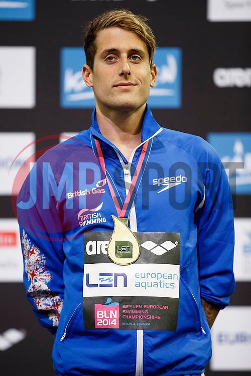 Chris Walker-Hebborn of Great Britain cel on the podium after he wins the Gold Medal in the Mens 100m Backstroke Final - Photo mandatory by-line: Rogan Thomson/JMP - 07966 386802 - 19/08/2014 - SPORT - SWIMMING - Berlin, Germany - Velodrom im Europa-Sportpark - 32nd LEN European Swimming Championships 2014 - Day 7.