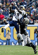 Navy receiver Tyree Barnes, (#89) catches a pass over Army defensive back Antuan Aaron, (#27) during the first half of the 109th. ARMY - NAVY game at Lincoln Financial Field in Philadelphia, PA on Saturday, December 6, 2008. Navy defeated Army 34 - 0.