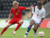 20090324: FUNCHAL, MADEIRA, PORTUGAL - Portugal vs Cape Verde: XIII Madeira International Under 21 Tournament. In picture: Fabio Coentrao (Portugal) and Valter Borges (Cabo Verde). <br />