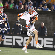 Domenic Sebastiani #45 of the Denver Outlaws jumps as he loses the ball during the game at Harvard Stadium on May 10, 2014 in Boston, Massachusetts. (Photo by Elan Kawesch)