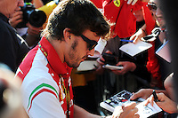 Fernando Alonso (ESP) Ferrari signs autographs for the fans.<br /> Italian Grand Prix, Saturday 6th September 2014. Monza Italy.