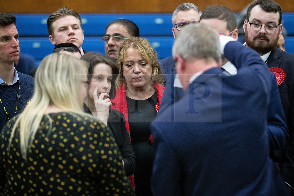 © Licensed to London News Pictures . 13/12/2019. Bury, UK. Labour Party candidate in Bury South LUCY BURKE (c) looks on as the Returning Officer confirms spoiled ballots with the candidates , at the count for seats in the constituencies of Bury North and Bury South in the 2019 UK General Election , at Castle Leisure Centre in Bury . Photo credit: Joel Goodman/LNP