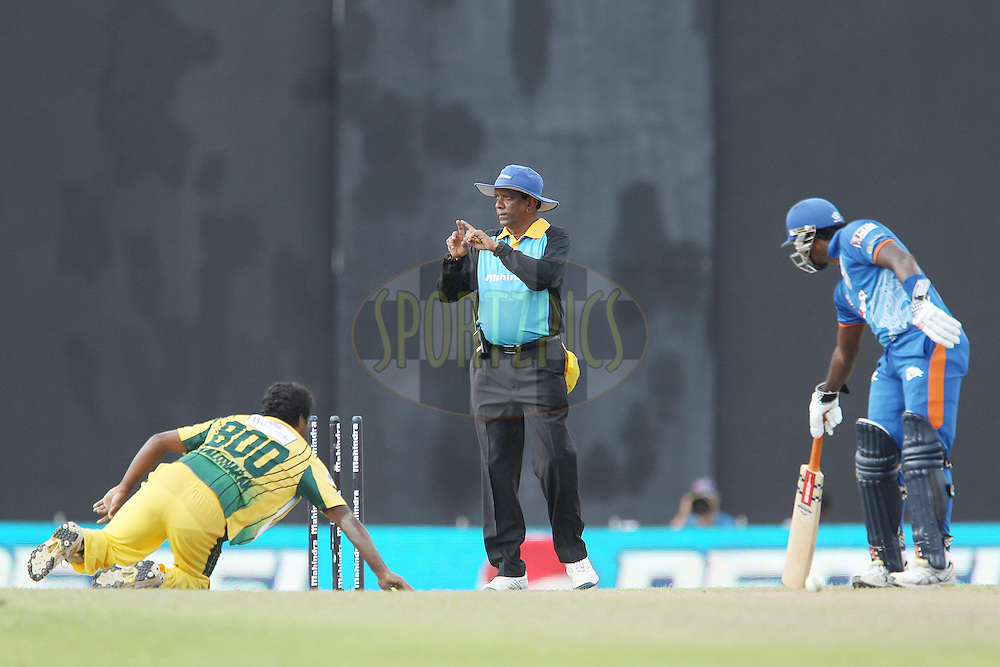 Muthiah Muralitharan dives to touch the ball onto the wicket and run out Angelo Mathews and the umpire calls for the tv umpire's decisionduring match 19 of the Sri Lankan Premier League between  Uthura Rudras and Nagenahiras held at the Premadasa Stadium in Colombo, Sri Lanka on the 26th August 2012. .Photo by Ron Gaunt/SPORTZPICS/SLPL