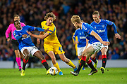 Fabio Silva (#49) of FC Porto is tackled by Glen Kamara (#18) of Rangers FC, as Steven Davis (#10) and Filip Helander (#5) of Rangers FC watch on during the Group G Europa League match between Rangers FC and FC Porto at Ibrox Stadium, Glasgow, Scotland on 7 November 2019.