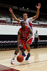 Nov 15, 2011; Stanford CA, USA;  Fresno State Bulldogs forward Kevin Foster (24) dribbles past Southern Methodist Mustangs forward Ricmonds Vilde (5) during the first half of a preseason NIT game at Maples Pavilion.  Mandatory Credit: Jason O. Watson-US PRESSWIRE