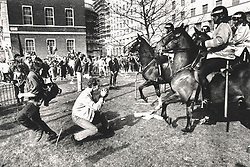 © Licensed to London News Pictures. 25/03/2020. London, UK. In this image from March 31st 1990 police horses are seen in action outside the Ministry of Defence during the London poll tax riots. The protest on the last day of March in 1990 started peacefully when thousands gathered in a south London park to demonstrate against Margaret Thatcher's Government's introduction of the Community Charge - commonly known as the poll tax. Marchers walked to Whitehall and Trafalgar Square where violence broke out with the trouble spreading up through Charring Cross Road and on to the West End. Police estimated that 200,000 people had joined the protest and 339 were arrested. The hated tax was eventually replaced by the Council Tax under John Major's government in 1992.  Photo credit: Peter Macdiarmid/LNP