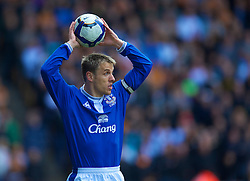 WOLVERHAMPTON, ENGLAND - Saturday, March 27, 2010: Everton's captain Phil Neville takes a throw-in against Wolverhampton Wanderers during the Premiership match at Molineux. (Photo by David Rawcliffe/Propaganda)