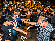 23 OCTOBER 2015 - YANGON, MYANMAR: Shia men pound their chests in the street during Ashura observances at Mogul Mosque in Yangon. Ashura commemorates the death of Hussein ibn Ali, the grandson of the Prophet Muhammed, in the 7th century. Hussein ibn Ali is considered by Shia Muslims to be the third imam and the rightful successor of Muhammed. He was killed at the Battle of Karbala in 610 CE on the 10th day of Muharram, the first month of the Islamic calendar. According to Myanmar government statistics, only about 4% of the population is Muslim. Many Muslims have fled Myanmar in recent years because of violence directed against Burmese Muslims by Buddhist nationalists.  PHOTO BY JACK KURTZ