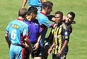 Hawke's Bays Aaron Jones pushes Wellington's Justin Gulley. ASB Premiership Football - Team Wellington v Hawke's Bay United, David Farrington Park, Wellington, New Zealand on Saturday 23 February 2013. Photo: Justin Arthur / photosport.co.nz