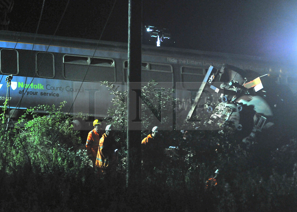 LITTLE CORNARD. SUDBURY. SUFFOLK.  Safety inspectors and Maintenance workers prepare to lift the train carriages and truck involved in yesterday's level crossing train crash. Twenty one people were hurt, two seriously, when a train derailed in a crash with a lorry on a level crossing. in Little Cornard in Suffolk on 17th August. 18 August 2010. STEPHEN SIMPSON..