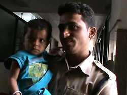 May 24, 2017 - MADHYA PRADESH, INDIA - MADHYA PRADESH, INDIA - MAY, 22, 2017 : 17-months-old toddler pictured with police constable during his general check-up at district hospital in Damoh district of Madhya Pradesh, India.....He was spotted crying and consuming his mum's milk unaware she is lying dead on a railway track. The spectators of the incident were left emotional to see the mum-child bond and some even could not step themselves from shedding tears. ....The child was taken to District Hospital for general check-up and Child Welfare Committee was informed to make arrangements for the child to be sent to an orphanage.....Pictures supplied by : Cover Asia Press (Credit Image: © Cover Asia Press/Cover Asia via ZUMA Press)