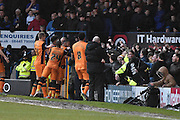 HUll City Forward, Chuba Akpom is mobbed by team mates and fans during the The FA Cup fourth round match between Bury and Hull City at Gigg Lane, Bury, England on 30 January 2016. Photo by Mark Pollitt.