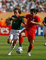Photo: Glyn Thomas.<br />Mexico v Iran. Group D, FIFA World Cup 2006. 11/06/2006.<br /> Mexico's Gerardo Torrado (L) and Iran's Mehdi Mahdavikia.
