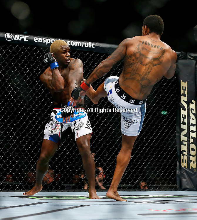 08.03.2014 London, England. Michael Johnson (white shorts) fights and beats Melvin Guillard (wjite and red logo shorts) in a 3 round Lightweight bout on the Main Card at UFC Fight Night London from the O2 Arena.