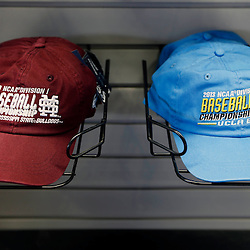 Jun 24, 2013; Omaha, NE, USA; Mississippi State Bulldogs and UCLA Bruins baseball caps are on display at the merchandise shop before game 1 of the College World Series finals at TD Ameritrade Park. Mandatory Credit: Derick E. Hingle-USA TODAY Sports