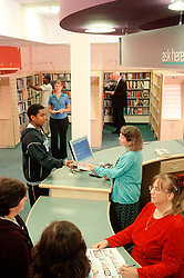 Interior of library with public and librarians Hendon London UK