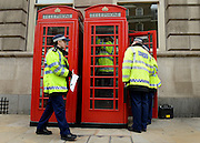 © Licensed to London News Pictures. 08/05/2012. Westminster, UK Police carry out security checks to public phone boxes along Whitehall in Westminster today 8th May 2012 ahead of the Queen's Speech to Parliament tomorrow. The Queen's Speech on Wednesday will set out the government's plans. Photo credit : Stephen Simpson/LNP