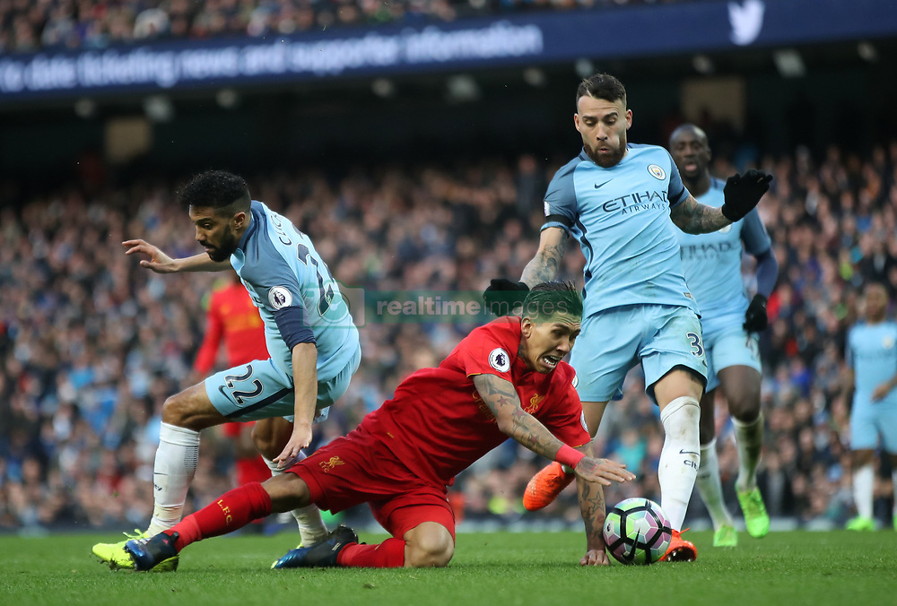 Manchester City's Gael Clichy (left) fouls Liverpool's Roberto Firmino to concede a penalty during the Premier League match at the Etihad Stadium, Manchester.