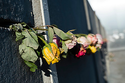 Flower tributes to those killed trying to cross Berlin Wall at  Berlin Wall Memorial on Bernauer Strasse in Berlin, Germany